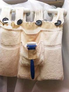 Make a towel caddy that you can hang off the shower curtain rod. | 44 Cheap And Easy Ways To Organize Your RV/Camper