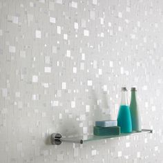 Create a bright, fresh look with subtle hints of shimmer with this 'Spa' wallpaper. This design, created using light and non-intrusive whites and blues, is ideal for bathrooms and can be cleaned with a sponge or even scrubbed if necessary for easy maintenance. Spa is both durable and attractive and can give that stylish kick to what could be a dull bathroom.
