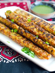 These chicken kebabs are the beautiful offspring from the marriage of the Persian Koobideh and the seekh kebab from the Indian Subcontinent Lebanese Recipes, Turkish Recipes, Greek Recipes, Indian Food Recipes, Persian Food Recipes, Persian Kabob Recipe, Seekh Kebab Recipes, Seekh Kebabs, Desi Food