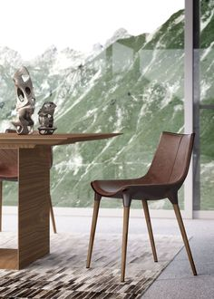 The award-winning Langham dining chair features modern curves with mid-century flare. Chair features fiberglass bucket seat construction with Brazilian wood legs. Padded seat finished in natural distressed leather. COM available for contract orders.