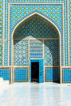A bright blue door in the wildly patterned Blue Mosque, also known as the Shrine of Hazrat Ali in Mazar-i-Sharif, Afghanistan.