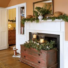 love this idea of putting an old trunk in front of a fireplace and decorating it seasonally.