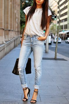 Simple, but so sexy!  Tucked in white tee, skinny jeans and strappy heels. Women's casual street style fashion clothing outfit for fall and spring