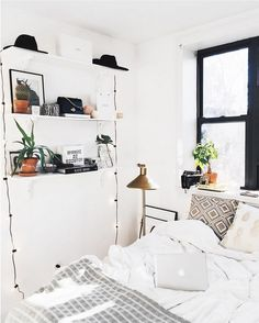 LOOK AT THE SPACING. Shelves on the side, window like mine, and bed centered