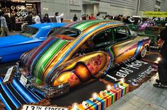 1949 Chevy Fastback is crazy colorful with lowrider flare. Its not for everyone, but you got to respect the talent that went into the build.