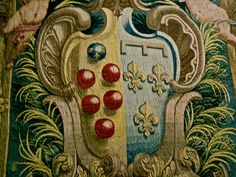 the Medici 'palle' (5 red balls) on the family shield or coat of arms, in a tapestry at the Uffizi exhibition 2012, Florence #Firenze