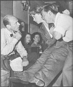 Fred Astaire helps Judy Garland and Mickey Rooney with choreography during their 1943 war bond tour with the Hollywood Cavalcade