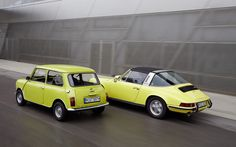 Classic Mini and Porsche 911. Need I remind you who is in the lead? Hmmm? And that's an old Mini, too.