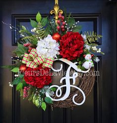 NEW ITEM!  Newest item just added to my store! This wreath is GORGEOUS and so bright and colorful!  Shown on an 18 grapevine base with moss, beautiful mixed flowing greens of ferns, ivies, evergreens, ficus leaves and more. Beautiful hydrangeas of red and white with red snow berries, silver berries, white berries, mixed evergreens, red ornaments. An adorable snowman ornament with a 12 white monogram and decorative Christmas Gingham plaid bow make up this rustic and festive holiday wreath!  I…