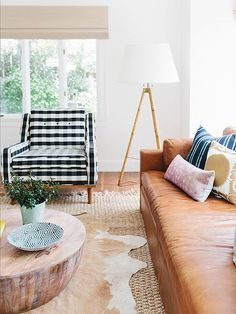 These days, decorating with buffalo plaid means new colors, new techniques, and big, bold decor.
