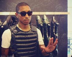 """Quite cool """"kevlar vest"""" look but also looks very useless (Pharrell & Moncler)"""