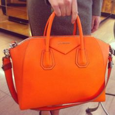 This bright purse adds a pop of color to your outfit and doubles as a laptop bag.