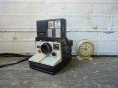 Vintage Polaroid Camera with Flash Attachment  by KnickofTime, $13.00 . I think I want this so I don't have to worry about going to get photo paper for digital cameras.