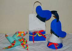 Donald Duck! Made from White Posterboard, BluePosterboard, yellow posterboard, red ribbon AND a  mini white feather boa