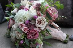 Beautiful bouquet designed with antique green and purple hydrangea, silver brunia, dusty miller, lavender roses, lady moon roses, clematis vine, dahlias, gomphrena, seeded euc, astrantia, spray roses, and quicksand roses.