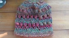 """Crochet Slouchy Bobble Hat, Purple and Green Tones - Handmade. A soft and comfortable slouchy hat with lines of bobbles on all around. The colours vary from tones of green to purple. Size - 20"""" around x 12"""" high (app. 51 cm x 30 cm) Yarn Manufacturer Washing Instructions - Machine wash and tumble dry. Do not bleach. Do not iron. Machine washable and dryable."""