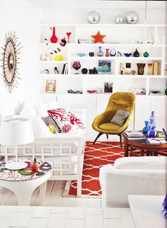 white with pops of color. Loving the rug!