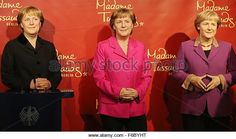Berlin, Germany. 16th Nov, 2015. Three wax figures depicting German Chancellor Angela Merkel are on display at the Madame Tussauds wax museum in Berlin, Germany, 16 November 2015. The wax figure on the left depicts Merkel during her first administration from 2005, her second administration from 2009 and third administration from 2013. The wax figures are being showcased on the occasion of Chancellor Merkel's 10th anniversary in office. Photo: Wolfgang Kumm/dpa/Alamy Live News - Stock Image