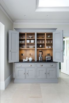 Stunning bespoke dresser with double bi-fold doors with storage for smaller appliances, crockery and glassware - the perfect storage unit. Kitchen Larder, Barn Kitchen, Cute Kitchen, Kitchen Cabinetry, New Kitchen, Kitchen Dining, Kitchen Decor, Kitchen Ideas, Dining Room Dresser