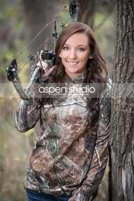 Love the idea of country senior pics. Bow and camo! Cute!