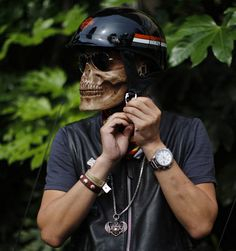 Motorcycle helmet with built-in skull mask.....so Kool...& Look at the hospital bracelet!!!!! Crazy Brave!!!!