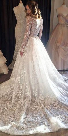 a line lace wedding dresses with long sleeves train lazaro bridal