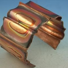Fold formed copper bracelet with heat patina. Copyright GeltDesigns. All rights reserved.