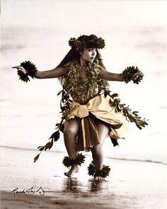 Hawaiian Hula dancer on the oceans edge in b&w