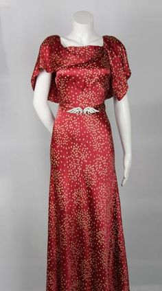 1930s vintage evening dress- focuses on the waist w/ rhinestone buckles, beautiful red dotted fabric