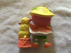 http://www.ebay.com/itm/Vintage-STRAWBERRY-SHORTCAKE-Miniature-Figure-1984-PEACH-BLUSH-MELONIE-BELLE-pvc-/172260432531?hash=item281b859a93:g:uRgAAOSwZ1BXdwGz