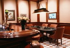 Not really a man cave, those paintings gotta go!!! But, nice poker table and fancy bar!