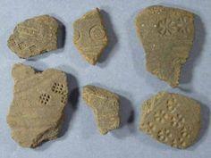 Potsherds stamped with decorative motifs. Bingham.