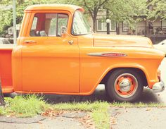 Um, hmmm, let's see, an orange vintage truck? Um, HELLS yeah!!!