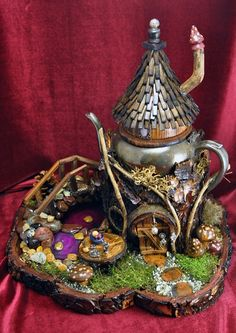 Recycled teapot fairy house - wow! would love to create something this beautiful.