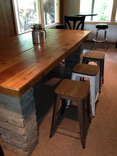Rustic DIY Pub Table - landscape blocks for legs and wood from old grainery for tabletop.