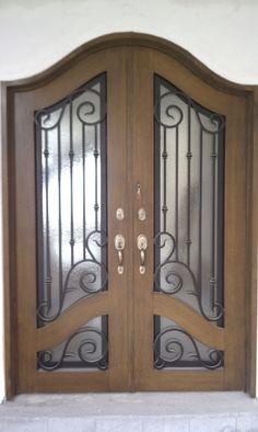 Beautiful front door with faux wrought iron door insert for Puertas principales de forja