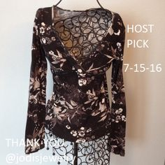 """Express Black long sleeve, pullover top. Black with design. V neck. Bodice seam on front. Gently worn. Tighter fit. Length is 21"""". Across front is 14 1/2"""". Express Tops"""