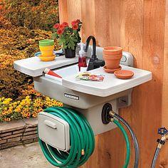 Outdoor Garden Sink :: $99.99 | imrpovementscatalog.com :: Has a hose reel, sink cover, and an actual faucet! BRILLIANT!! | #gardenhose