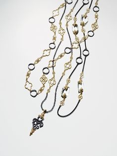 ARMENTA  18-karat yellow gold and oxidized sterling silver chain necklaces.