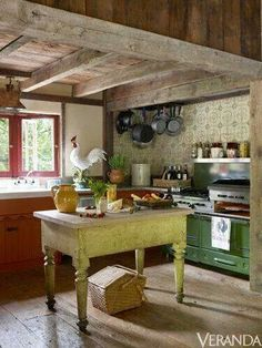 Rustic kitchen with unfinished wood beams.