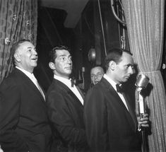 Sands general manager Jack Entratter, left, waits backstage with rat pack members Dean Martin, Frank Sinatra and Joey Bishop before a performance at the Sand's Copa room.