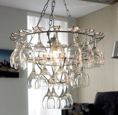 Okay, I am not quite sure how I could do this, but my wheels are spinning. I had found this on a home decorating site. This Vino Chandelier as they had called it was $300. I know I can do it for less. Hugs, Linda :)