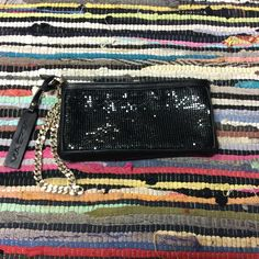 """Via Spiga Wristlet💜💜 Ooo la-laaaaaa😍😍 VIA SPIGA genuine leather, black and gold wristlet!!! Hot, hot, hot!!!🔥🔥🔥 Black chainmaille, mesh front with leather back! Thick gold zipper with gold chainlink strap! PERFECT for a HOT night out!!!! 8.5"""" x 4"""" with 7"""" wrist strap!! Sizzlinnnnn' gorgeous and NOT a cheapo!! Via Spiga Bags Clutches & Wristlets"""