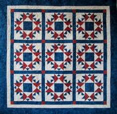 Star Sparkle Wall Hanging Pattern Inspired by an antique quilt, this wall hanging is made with half square and quarter square triangle. Star Quilts, Quilt Blocks, American Flag Quilt, Painted Barn Quilts, Patriotic Quilts, Patriotic Crafts, Red And White Quilts, Cute Quilts, Baby Quilts