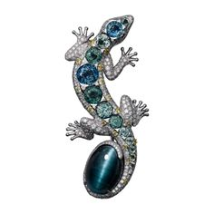 High Jewelry brooch High Jewelry <br />Cartier Royal <br />brooch, 18K white gold, one 13.71 carat cat's eye tourmaline, colored sapphires, yellow diamond eyes, yellow and white brilliant-cut diamonds.