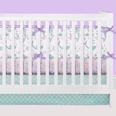 We are swooning over this mermaid baby bedding set! This completely custom crib bedding features mermaid crib bumpers, a seashell crib sheet, and a mermaid scale ombre crib skirt ❤ Don't miss the star
