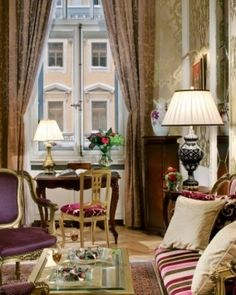 Renovated One-Bedroom Suites have a grand style, with rich furnishings and original antiques. Grand Hotel Europe, St. Petersburg, Russia