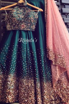emerald green and coral sprinkle story lehenga by Rianta's Designer lehnga choli, Designer dresses indian, Indian designer outfi. Lehenga Choli Designs, Designer Lehnga Choli, Bridal Lehenga Choli, Designer Bridal Lehenga, Indian Lehenga, Half Saree Designs, Indian Bridal Outfits, Indian Wedding Gowns, Indian Gowns Dresses