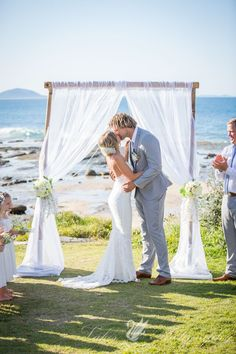 The most beautiful wedding day for such a devine couple. Our bamboo arbour set up at gorgeous Point Cartwright beach, Sunshine Coast, Queensland.  www.dreamweddingceremonies.com.au