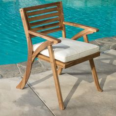 You are on the hunt for more chairs for your patio set, than look no further than these wooden arm chairs. With soft curved lines and a sturdy frame, these chairs are a must have. The water resistant fabric of the cushions will stand up to the little messes of life, allowing you to use these arm chairs to the fullest extent.